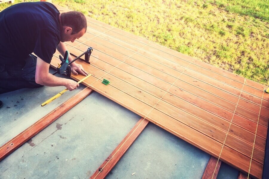 A man doing decking service